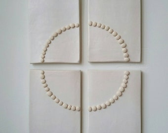 FOCUS  ceramic wall art modern relief sculpture zen meditation simplicity circle by artist Tina Schowalter Alma Artisan wall art hanging