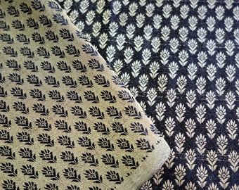 Black brocade fabrix with golden leafy pattern