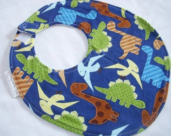 Baby Boy Bib - Dinosaurs on Blue - terry cloth backing