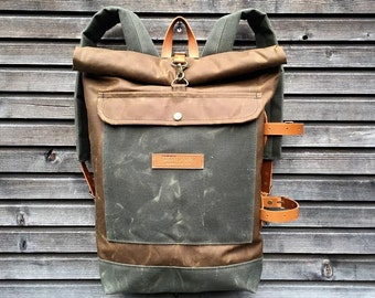 Waxed canvas backpack with detachable leather side straps and padded laptop compartment / padded shoulder straps