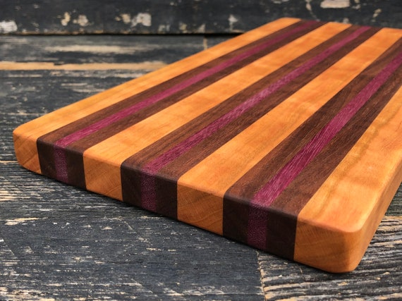 Handmade cutting board made from cherry, purple heart and walnut woods