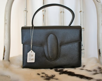 50s vintage black leather handbag with top handle made by Mastercraft made in Canada metal snap closure in front