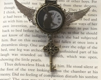 Hand made Steampunk Alice in Wonderland inspired winged brooch badge