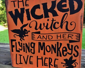 Halloween Decor/Wicked Witch and her Flying Monkeys Live Here/Flying monkeys/Halloween Sign/ Wall Decor/Shelf Sitter/Orange/Black