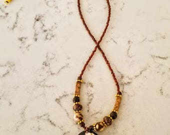 LSD Peg Montana brown and topaz single strand beaded necklace with brown agate drop