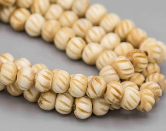 Round Carved Bone Beads 7x8mm 32 Beads SKU-BSS-8