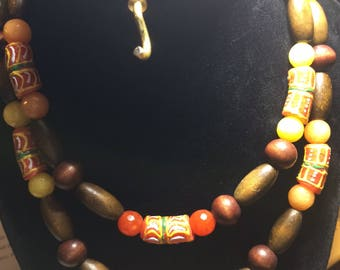 colorful african necklace, of fair trade krobo beads, paired with wooden beads and colored glass
