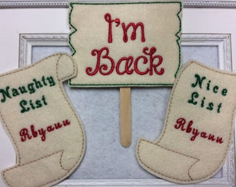 Signs for one of Santa's elves      I am Back ,      Naughty List, Nice List