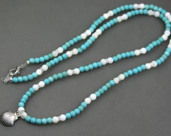 Antiqued sterling silver shell pendant on strand of turquoise magnesite and white shell