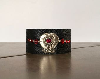Black leather bracelet with 960 precious metal clay piece crafted with a red garnet CZ with crystals and sterling silver beads