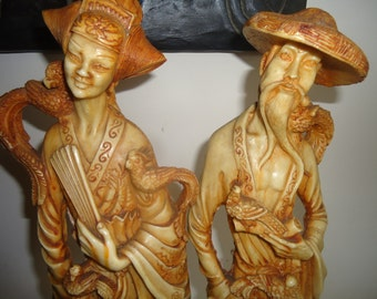 Two chinese statues the bird man and his wife made from bone