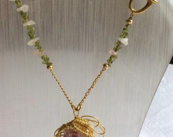 Solar quartz pendant on peridot and rose quartz necklace.