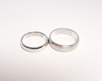 wedding rings with finger prints
