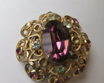 Signed Coro - goldtone vintage pin/brooch with amethyst and white rhinestones