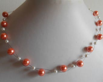 Bridal twist of coral and white beads