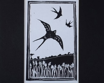 "Original lino cut print of flying swallows over a corn field in black and white. ""Summer Swallows"". Professionally mounted."