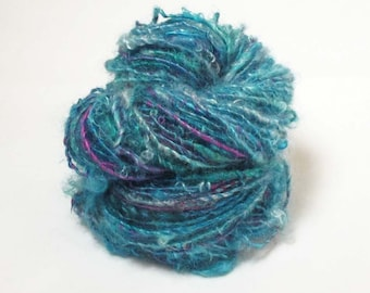 Handspun Singles from Kid Mohair Locks in shades of blue with silk accents in violet