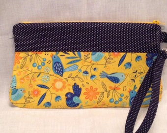AK11- Completat Clutch: in a fun blue bird on yellow print with pleated front, zipper closure and detatchable hand strap