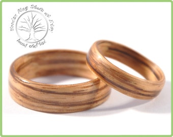 Wedding ring set for him and her. Matching wedding band set made of Zebra Wood