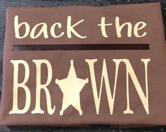 Back the Brown. Supporting Deputy Sheriffs throughout Indiana.  These are available in brown, beige, and white t shirts.