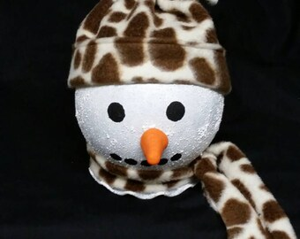 This is a cute, adorable light up snow person with a giraffe print scarf and hat.