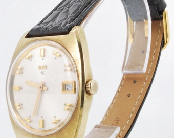 Elgin vintage wrist watch with date, 17 Jewels, heavy gold-toned & stainless steel water resistant case