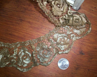 """2 1/2"""" wide of a lovely rose design antique gold metal lace 36 1/2"""" long"""