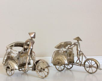 Two Antique Silver miniature Rickshaw propelling bicycles with carts, Jokia/Jakarta.