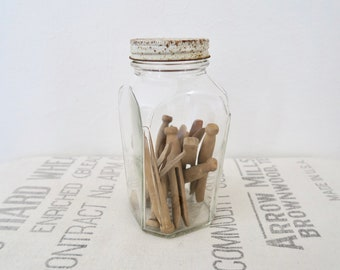 Vintage Good Housekeeping Clear Glass Jar with White Metal Lid Full of Wooden Clothespins
