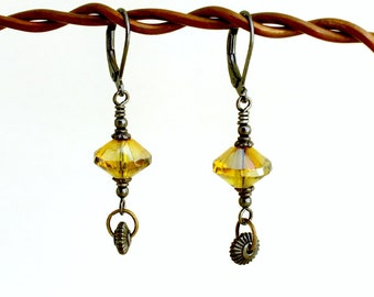 Black and Yellow earrings with spinning gears - Gunmetal Steampunk earrings with misted yellow rivoli beads