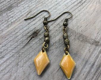 Mustard yellow enameled and bronze earrings