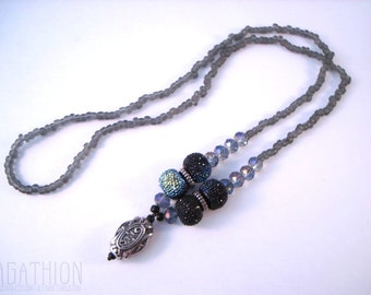 Shiny Silver Drop Beaded Necklace with large black textured disco ball beads and sparkly blue beads and gray seed beads