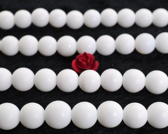 63 pcs of Ceramic matte round beads in 6mm