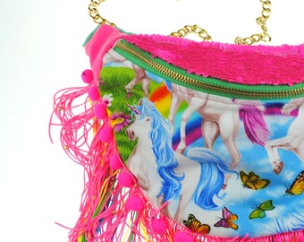 DOLLY unicorn pink neon sequin bumbag fannypack. Rainbow pompom fringe, gold chain belt.