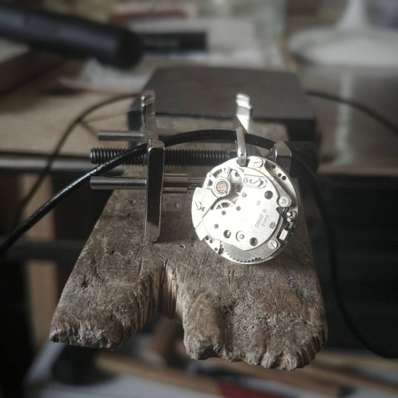 steel necklace and leather with an old Swiss watch movement