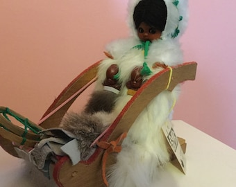 Indien art Eskimo doll on sled with babies and fur