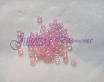 10 gr - 2x2mm hole 1 mm iridescent pink seed beads.