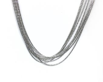 Multi strand mesh 925/1000 silver spike necklace.