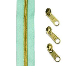 1 m endless zipper divllisiert mint/gold + 3 zipper