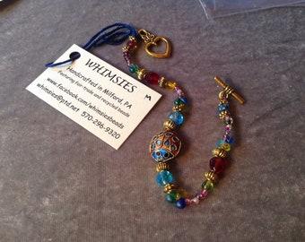 Glass beaded bracelet, size MEDIUM. multicolor, cloisonne ladybug, Boho, hippie, fair trade, gift, free shipping. Made in USA.