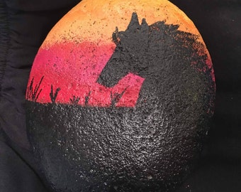 Hand painted rock of sunset silhouette of horse
