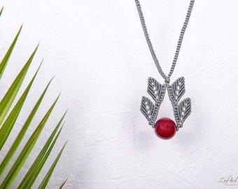 Long grey macrame leaves necklace with red semiprecious stone.