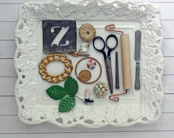 bITs KitS No041d -tin stencil, scissors, chandelier crystal, doll leg, play knife, metal leaves, earring, handle, button