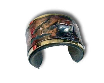 copper cuff patinated and oxidized iron and leather interior