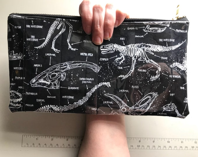 Dinosaur skeleton wristlet/clutch (Made of fabric with clear vinyl top layer)