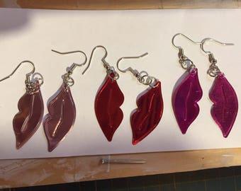 Shiny dangly lip earrings