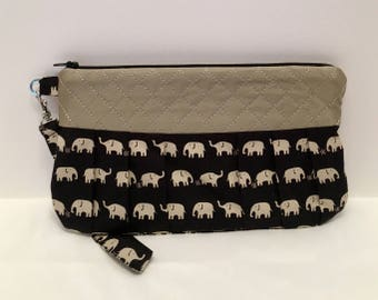 AK21- Compleat Clutch: in a fabulous elephant print with pleated front, zipper closure and detatchable hand strap