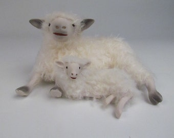 English Cotswold Lamb Spooning With Mommy
