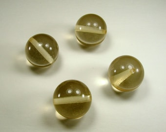 Set of 4 synthetic pearls, 24.5 mm, champagne, translucent.