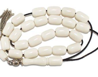 Greek komboloi made of natural Bone and silver .